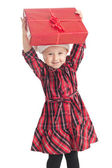 Little girl with xmas gift — Stock Photo