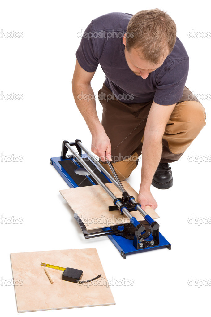 Photo shot of man cut tiles — Stock Photo #7207223