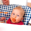 Feeding baby food to baby — Stock Photo #7764105