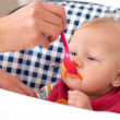 Feeding baby food to baby — Stock Photo #7764137