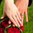Stock Photo: Hands with rings on wedding bouquet