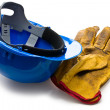 Blue hardhat and leather working gloves — Stock Photo