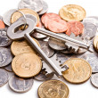 Safe key with coins - Stockfoto
