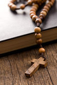 Wooden rosary beads and holy bible — Stock Photo