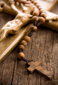 Wooden rosary beads and crucifix — Stock Photo