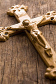 Crucifix on wooden background — Stock Photo