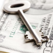 Safe key with money - Stockfoto