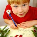 Writing christmas wishes — Stock Photo