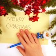 Writing christmas wishes — Stock Photo #7669703