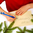 Writing christmas wishes — Stock Photo #7669708