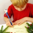 Stock Photo: Writing christmas wishes