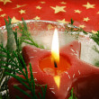 Christmas candle in ice bowl - Stock Photo