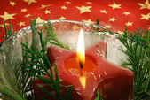 Christmas candle in ice bowl — Stock Photo