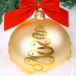 Golden xmas bauble — Stock Photo