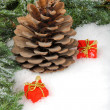 Cone and gift boxes laying on snow — Stockfoto