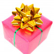 Christmas pink gift box with golden ribbon — Stock Photo