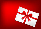 White envelope with red ribbon — Stock Photo