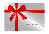 Gift card with red ribbon — Stock Photo