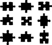 Blank and black puzzle pieces — Stock Photo