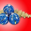 Royalty-Free Stock Photo: Christmas concept with baubles on red