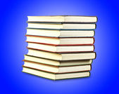 A stack of old books in the blue — Stock Photo