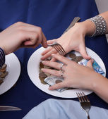 Hand with a fork for the money runs — Stock Photo