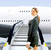 Flight attendant near moving ramp — Stock fotografie