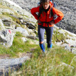 Young woman trekking in the mountains — Stock Photo
