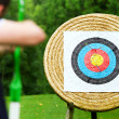 Stock Photo: Archer takes aim at target