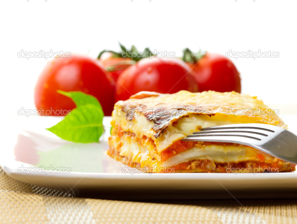 Italian lasagna dish with tomatoes — Stock Photo #6929838