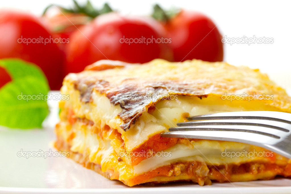 Italian lasagna dish with tomatoes — Stock Photo #6929840