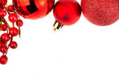 Chrismas baubles and red berries — Stock Photo