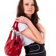 Beautiful brunette with red purse — Stock Photo