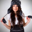 Young brunette in fur hat — Stock Photo