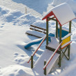 Kids playground in winter scenery - Stock Photo