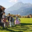 Group of scarecrows in female dress standing on a field — Stock Photo