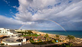 Rainbow over sea and beach in Tunisia — Stock Photo