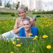 Two female students with a laptop in the park — Stock Photo