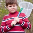 Boy with a butterfly net for catching butterflies — Stock Photo #7053947