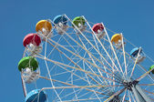 "Attraction ""Ferris Wheel"" on a background of blue sky — Stock Photo"