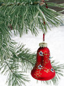 A beautiful red Christmas decorations on a snowy Christmas tree — Stock Photo