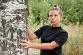 Russian middleaged woman stands of birch — Stock Photo