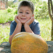 Boy with a big melon in his hand, harvest — Stock Photo