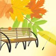 Wooden bench and umbrella on the autumn background — Stock Vector #7090232