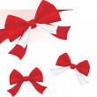 Three red bows isolated on the white — Stock Vector