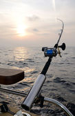 Single fishing-rod on a boat — Stock Photo
