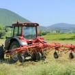 tractor in plowed field — Stock Photo