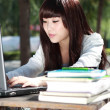 A smiling Asian student is studying. — Stockfoto #7140739