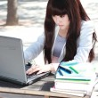 A smiling Asian student is studying. — Stockfoto #7140760