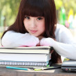 Stockfoto: A smiling Asian student is studying.